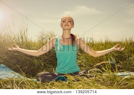 Beauty Fit Blond Young Woman Meditating On The Nature With Eyes Closed