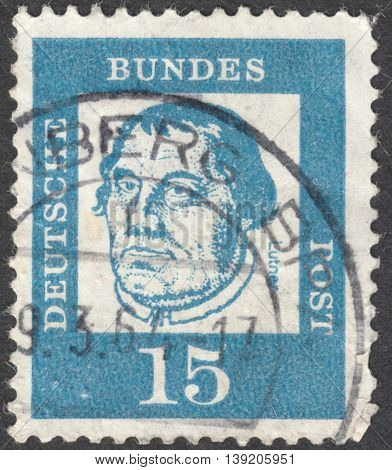 MOSCOW RUSSIA - JANUARY 2016: a post stamp printed in GERMANY shows a portrait of Martin Luther the series