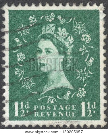 MOSCOW RUSSIA - JANUARY 2016: a post stamp printed in the UNITED KINDOM shows a Portrait of Queen Elizabeth II circa 1960