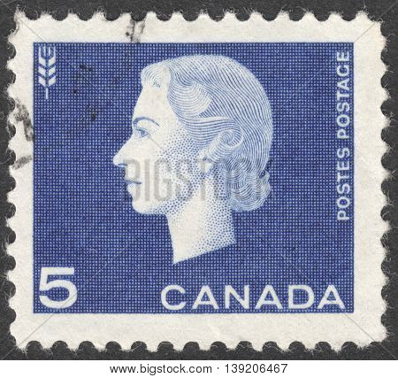 MOSCOW RUSSIA - JANUARY 2016: a post stamp printed in CANADA shows a portrait of Queen Elizabeth II the series