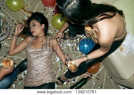 Young Asian woman fainted at the party