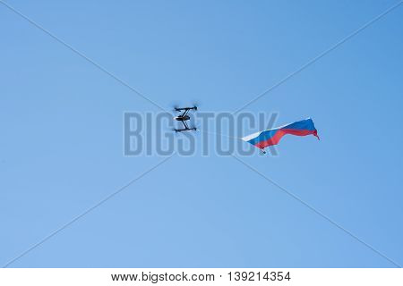 St. Petersburg Russia - June 4 2016: Russian Federation State flag flown on drone. Blue sky.
