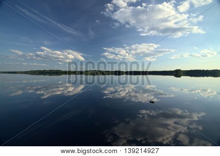 Beautiful cloudscape with reflections on Faangsjoen in Sweden. poster