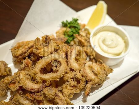 Deep fried calamari ring on dish in the restaurant (Selective focus)