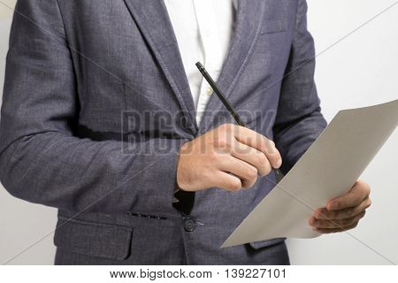Businessman Signs The Document