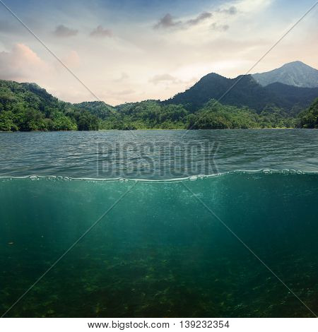 Sea landcape design template with underwater part and coast mountain splitted by waterline