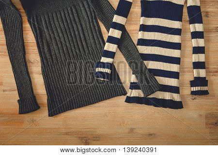 Knitted Wears on the Wooden Background.Hand Made;Fancywork.knitting industry.Top View