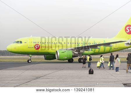 MOSCOW, RUSSIA - SEPTEMBER 26, 2014: Spotter plane photographed S7 Airlines during taxiing. Moscow Domodedovo Airport organizes regular spotting on its territory.