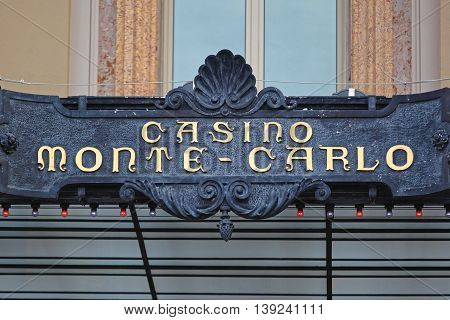 MONTE CARLO MONACO - JANUARY 19: Sign at Casino Monte Carlo on JANUARY 19 2012. Golden Letters at Entrance in Casino Building in Monte Carlo Monaco.