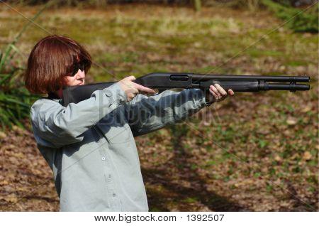 Woman Aiming A Shotgun
