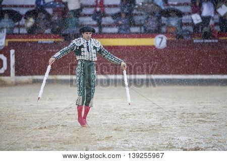 Jaen SPAIN - October 18 2008: The Spanish Bullfighter during a rainy afternoon bullfighting in the Bullring of Jaen Spain