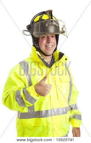 Friendly fire fighter giving the thumbs up sign.  Isolated on white.