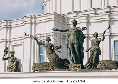 MINSK, BELARUS - June 2, 2015: Statues and on Facade Of The National Academic Bolshoi Opera and Ballet Theatre of the Republic of Belarus In Minsk.