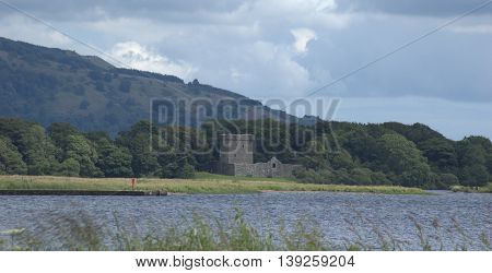 Loch Leven Castle ruins on an island in Loch Leven Kinrosshire Central Scotland. It was here that Mary Queen of Scots was held prisoner until she made a daring nighttime escape. The castle is accessed by tourist boat trips during the summer months. Loch L