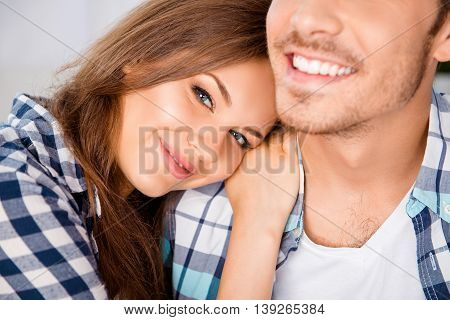 Closeup Photo Of Happy Girl Huging Her Smiling Boyfriend