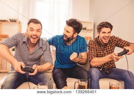 Men's Contest! Excited Happy Cheerful Man Play Video Game With His Friends