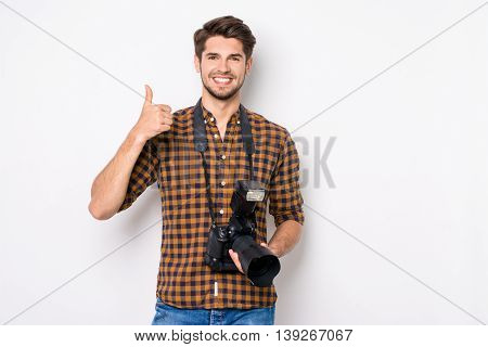 Young Happy Photographer Holding Camera And Showing Thumb Up