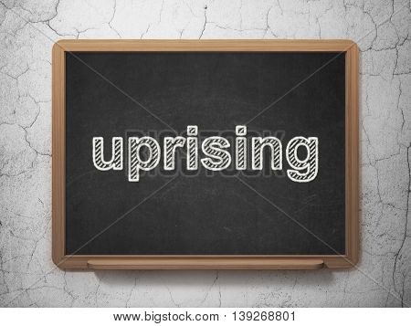Politics concept: text Uprising on Black chalkboard on grunge wall background, 3D rendering