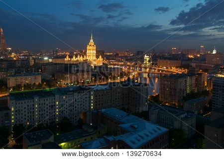 Residential buildings, Royal Hotel Radisson (Hotel Ukraina) near river at evening in Moscow