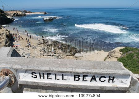 LA JOLLA, CALIFORNIA - JUL 2015: Shell Beach, La Jolla, California is a scenic Pacific Coast destination for tourist and locals, with rocky beaches, steady ocean waves and a sandy beach area.