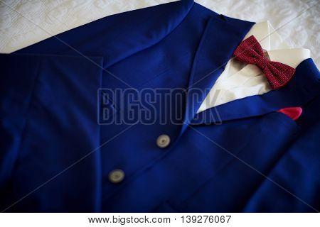 Blue suit with tie and handkerchief. Focused on handkerchief.