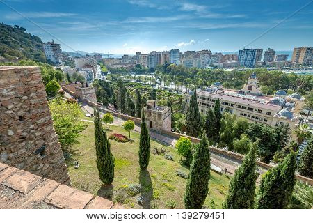 Aerial view at Alcazaba of Malaga with skyline of city, the best preserved Moorish fortress palace in Andalusia, Spain.