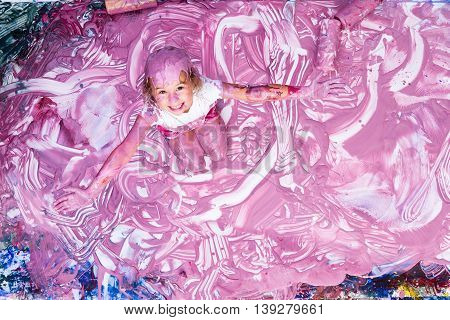 Excited Five Year Old Playing In Paint