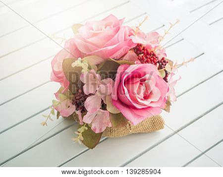 Bouquet Of Beautiful Artificial Flowers On White Wooden Table In A Coffee Shop