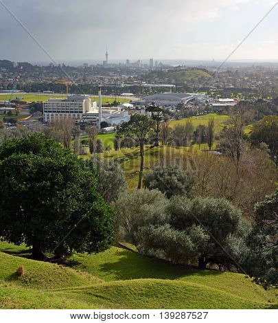 Auckland city landscape on a stormy winter day viewed from One Tree hill. In the foreground is Alexandra park and Epsom. In the background is Mount Eden and downtown Auckland the The Skytower.