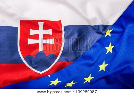 Flags of the Slovak Republic and the European Union. Slovak republic Flag and EU Flag. World flag money concept.