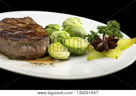 filet mignon isolated on a black background