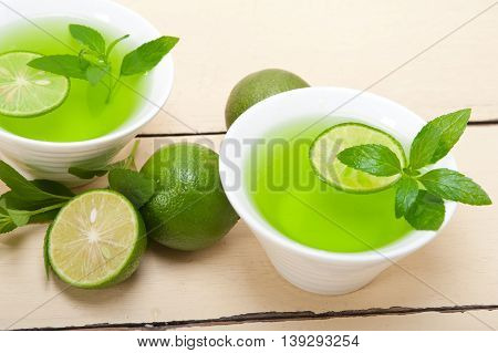 close up image of mint infusion tea tisane with lime
