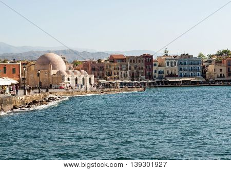 CHANIA, GREECE - JULY 9, 2016: Tavernas and restaurants surrounding the harbour of Chania Crete Greece