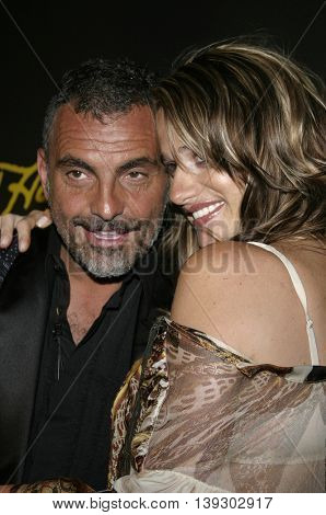 Christian Audigier and wife Ira at Christian Audigier Fashion Show Featuring New Ed Hardy Label held in Hollywood, USA on May 21, 2005.