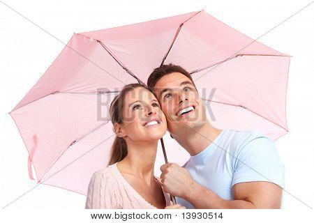 Happy smiling couple under a pink umbrella