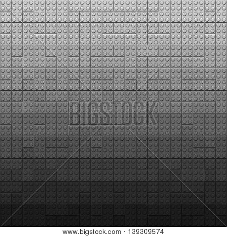 Plastic construction bricks background in dark gray colors
