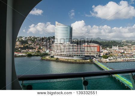 FORT DE FRANCE, MARTINIQUE -NOVEMBER 25, 2015 : Landscape of Fort-de-France Martinique harbor, piers, city and mountains.