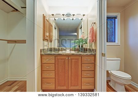 Simple Bathroom Interior With Vanity Cabinet And Granite Counter Top