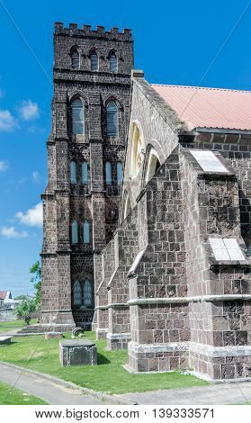 St. George Anglican Church - Basseterre, St. Kitts (1859) features a winding staircase to the operational bell tower. St. George's Anglican Church overlooks the city of Basseterre and the ocean beyond.