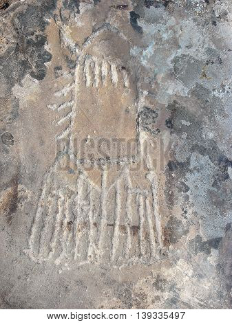 Rocket silhouette prehistorical petroglyph. Unknown flying object carved in rocks. Siberian Altai Mountains petroglyphs Russia