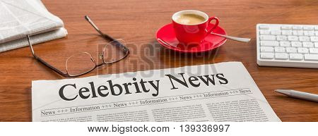 A Newspaper On A Wooden Desk - Celebrity News