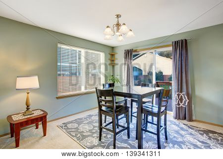 Dining Area In Green Tones With Black Table Set