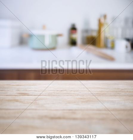 Table top with Blur Kitchen Pantry with kitchenware background