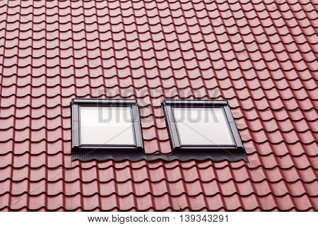 Red Metal tiled Roof with New Dormers. Roof Windows