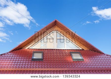 Red Metal tiled Roof with New Dormers Roof Windows Skylights and Roof Protection from Snow Board poster