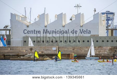 BARCELONA SPAIN - JULY 7 2016: The Municipal Sailing Centre is located in Barcelona Port Olimpic next to the beach. Nautical offers various courses - sailing catamaran windsurfing etc.