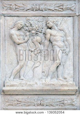 BOLOGNA, ITALY - JUNE 04: Temptation, Genesis relief on portal of Saint Petronius Basilica in Bologna, Italy, on June 04, 2015