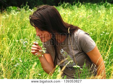 beautiful and modest girl resting in nature photo for micro-stock