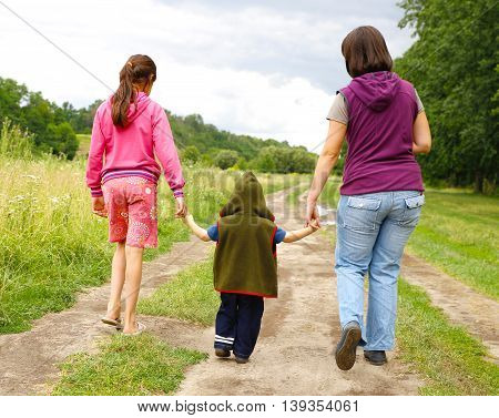gentle parental hands holding the child's hand photo for micro-stock