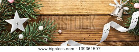 still life with christmas tree and silver decoration